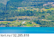 Купить «Olden, Norway, typical summer panorama of Norwegian village landscape, mountains and colorful traditional nordic houses», фото № 32285818, снято 4 августа 2020 г. (c) Николай Коржов / Фотобанк Лори