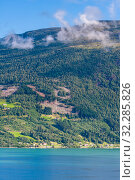 Купить «Olden, Norway, typical summer panorama of Norwegian village landscape, mountains and colorful traditional nordic houses», фото № 32285826, снято 4 августа 2020 г. (c) Николай Коржов / Фотобанк Лори
