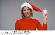 Купить «woman in santa helper hat having fun on christmas», видеоролик № 32286026, снято 7 октября 2019 г. (c) Syda Productions / Фотобанк Лори