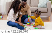 Купить «african family playing with baby daughter at home», видеоролик № 32286070, снято 7 октября 2019 г. (c) Syda Productions / Фотобанк Лори