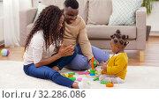 Купить «african family playing with baby daughter at home», видеоролик № 32286086, снято 7 октября 2019 г. (c) Syda Productions / Фотобанк Лори