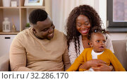 Купить «happy african family with baby daughter at home», видеоролик № 32286170, снято 7 октября 2019 г. (c) Syda Productions / Фотобанк Лори