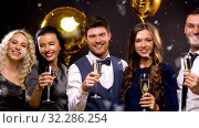 Купить «happy friends with champagne glasses at party», видеоролик № 32286254, снято 5 декабря 2019 г. (c) Syda Productions / Фотобанк Лори
