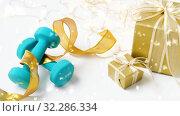 Купить «snowing over christmas gift boxes and dumbbells», видеоролик № 32286334, снято 13 ноября 2019 г. (c) Syda Productions / Фотобанк Лори