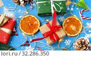 Купить «snowing over christmas gifts and decorations», видеоролик № 32286350, снято 13 ноября 2019 г. (c) Syda Productions / Фотобанк Лори