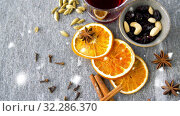 Купить «hot mulled wine, orange slices, raisins and spices», видеоролик № 32286370, снято 10 июля 2020 г. (c) Syda Productions / Фотобанк Лори