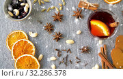 Купить «hot mulled wine, orange slices, raisins and spices», видеоролик № 32286378, снято 10 июля 2020 г. (c) Syda Productions / Фотобанк Лори