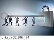 Купить «Concept of teamwork with businessmen unlocking lock», фото № 32286494, снято 6 декабря 2019 г. (c) Elnur / Фотобанк Лори