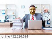 Купить «Businessman wearing mask in hypocrisy concept», фото № 32286594, снято 24 июня 2019 г. (c) Elnur / Фотобанк Лори