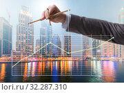 Businessman controlling the market with strings. Стоковое фото, фотограф Elnur / Фотобанк Лори