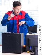 Купить «The computer repairman specialist repairing computer desktop», фото № 32288978, снято 19 января 2018 г. (c) Elnur / Фотобанк Лори