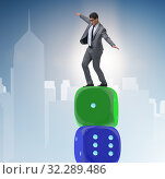 Купить «Businessman balancing on top of dice stack in uncertainty concep», фото № 32289486, снято 18 октября 2019 г. (c) Elnur / Фотобанк Лори