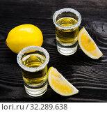 Купить «Tequila drink served in glasses with lime and salt», фото № 32289638, снято 18 сентября 2017 г. (c) Elnur / Фотобанк Лори