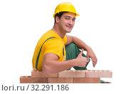 Купить «The handsome construction worker building brick wall», фото № 32291186, снято 5 ноября 2016 г. (c) Elnur / Фотобанк Лори