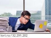 Купить «Workaholic businessman overworked with too much work in office», фото № 32291202, снято 11 октября 2016 г. (c) Elnur / Фотобанк Лори