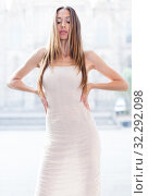 portrait of young female in sexually ivory midi gown standing in town. Стоковое фото, фотограф Яков Филимонов / Фотобанк Лори