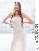 Купить «portrait of young female in sexually ivory midi gown standing in town», фото № 32292098, снято 24 июня 2017 г. (c) Яков Филимонов / Фотобанк Лори