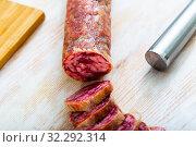 Купить «Spanish dry cured pork sausage Salchichon», фото № 32292314, снято 18 октября 2019 г. (c) Яков Филимонов / Фотобанк Лори