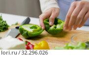 Купить «woman cutting pepper in half and removing seeds», видеоролик № 32296026, снято 10 октября 2019 г. (c) Syda Productions / Фотобанк Лори