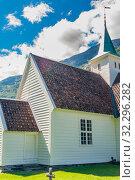 Купить «Norway, Sogn of Fjordane county. White wooden church in Olden», фото № 32296282, снято 6 августа 2020 г. (c) Николай Коржов / Фотобанк Лори