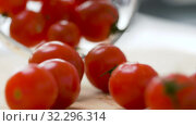 Купить «red ripe cherry tomatoes in glass bowl», видеоролик № 32296314, снято 10 октября 2019 г. (c) Syda Productions / Фотобанк Лори