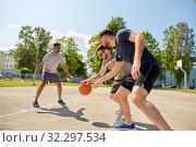 Купить «group of male friends playing street basketball», фото № 32297534, снято 21 июля 2019 г. (c) Syda Productions / Фотобанк Лори