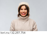 Купить «young woman in knitted winter hat and sweater», фото № 32297754, снято 30 сентября 2019 г. (c) Syda Productions / Фотобанк Лори