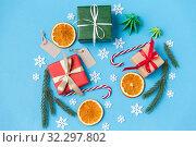 Купить «christmas gifts, branches, tags and decorations», фото № 32297802, снято 26 сентября 2018 г. (c) Syda Productions / Фотобанк Лори
