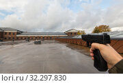 Купить «POV of male hands shooting with semi-automatic gun», фото № 32297830, снято 11 октября 2019 г. (c) Syda Productions / Фотобанк Лори