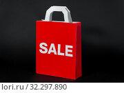 Купить «red shopping bag with sale word», фото № 32297890, снято 20 декабря 2018 г. (c) Syda Productions / Фотобанк Лори