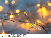 Купить «close up of electric garland lights», фото № 32297974, снято 26 сентября 2018 г. (c) Syda Productions / Фотобанк Лори