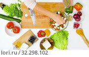 Купить «woman cooking vegetable salad with feta and spices», видеоролик № 32298102, снято 10 октября 2019 г. (c) Syda Productions / Фотобанк Лори