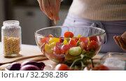Купить «woman cooking vegetable salad with pine nuts», видеоролик № 32298286, снято 10 октября 2019 г. (c) Syda Productions / Фотобанк Лори