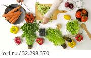 Купить «young woman chopping cucumber for salad at home», видеоролик № 32298370, снято 10 октября 2019 г. (c) Syda Productions / Фотобанк Лори