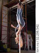 Купить «Beautiful slim girl with pylon. Female pole dancer woman dancing on a pole», фото № 32298542, снято 8 декабря 2019 г. (c) Яков Филимонов / Фотобанк Лори