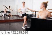 Купить «Female choreographer teaches young dancer in ballet studio», фото № 32298586, снято 26 апреля 2019 г. (c) Яков Филимонов / Фотобанк Лори