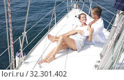 Купить «Young loving couple enjoying sea trip on pleasure sailboat on sunny summer day», видеоролик № 32301402, снято 30 июля 2019 г. (c) Яков Филимонов / Фотобанк Лори