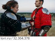 Купить «Medieval knight helps his friend to put on armor», фото № 32304378, снято 5 июля 2019 г. (c) Tryapitsyn Sergiy / Фотобанк Лори