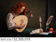 Купить «Red-haired girl in a historical suit plays the lute. Renaissance painting style.», фото № 32305078, снято 19 августа 2019 г. (c) Дмитрий Черевко / Фотобанк Лори