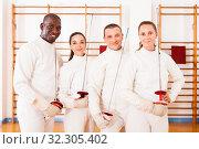 Купить «Men and women fencers posing with foils together», фото № 32305402, снято 11 июля 2018 г. (c) Яков Филимонов / Фотобанк Лори