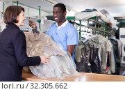 Купить «Administrator returning clothing to female client», фото № 32305662, снято 15 января 2019 г. (c) Яков Филимонов / Фотобанк Лори