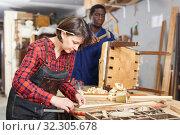 Купить «Artisans in process of renewing armchair», фото № 32305678, снято 2 февраля 2019 г. (c) Яков Филимонов / Фотобанк Лори