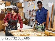 Купить «Artisans in process of renewing armchair», фото № 32305686, снято 2 февраля 2019 г. (c) Яков Филимонов / Фотобанк Лори
