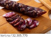Купить «Sliced french dry sausage», фото № 32305770, снято 21 октября 2019 г. (c) Яков Филимонов / Фотобанк Лори
