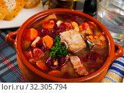 Купить «Pork vegetable soup with beans», фото № 32305794, снято 15 ноября 2019 г. (c) Яков Филимонов / Фотобанк Лори