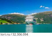 Купить «Luxury cruise liner MSC Meraviglia  In The Fjord Of Olden Norway», фото № 32306094, снято 7 августа 2020 г. (c) Николай Коржов / Фотобанк Лори