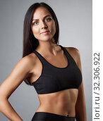 Купить «Pretty brunette fitness trainer studio portrait», фото № 32306922, снято 25 сентября 2016 г. (c) Гурьянов Андрей / Фотобанк Лори