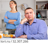 Купить «Man and woman are offended at each other because of the misunderstanding in his home», фото № 32307266, снято 24 февраля 2020 г. (c) Яков Филимонов / Фотобанк Лори