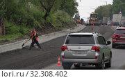 Купить «Road construction workers laying asphalt highway, pavement works, road repairing», видеоролик № 32308402, снято 7 августа 2019 г. (c) А. А. Пирагис / Фотобанк Лори
