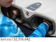 Купить «Woman process at cosmetology procedure with massage apparatus - hand press massage machine», фото № 32316642, снято 17 октября 2019 г. (c) А. А. Пирагис / Фотобанк Лори